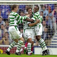 Fotball: Rangers v Celtic, Scottish Premier League, Ibrox Stadium, Glasgow.<br />Pic Ian Stewart, Sunday 30th. September, 2001.<br />Stilian Petrov celebrates the opening gosal with Didier Agathe and Alan Thompson, who scored the 2nd goal
