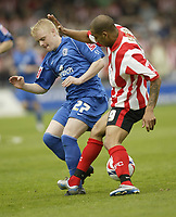 Photo: Aidan Ellis.<br /> Lincoln City v Rochdale. Coca Cola League 2. 06/05/2006.<br /> Rochdale's Gary Brown challenges Lincoln's Francis Green for possesion
