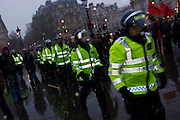 Met police riot officers form up during student protests in Trafalgar Square.