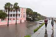 Tourists view the floodwater along the Battery area as Hurricane Joaquin brings heavy rain, flooding and strong winds as it passes offshore October 3, 2015 in Charleston, South Carolina.