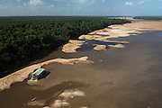 Gold Dredger<br /> Essequibo River<br /> GUYANA<br /> South America<br /> Longest river in Guyana