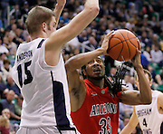 Arizona forward Jesse Perry (33)  attempts to score as BYU center James Anderson (15) defends during the second half of an NCAA college basketball game, Saturday Dec. 11, 2010 in Salt Lake City. BYU defeated Arizona 87-65. (AP Photo/Colin E Braley)