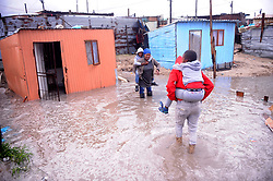 South Africa Cape Town 11 June 2020 Vuyiseka Mzi with her family struggling with flooded home. Flooded in Zwezwe Informal Settlement in Khayelitsha. All their belongings have been damaged as water continues to flood inside their homes due to heavy rains. Heavy rainfall has graced many areas in Khayelitsha and the rest of the province. The rest of the week is expected to bring even more rain, with gale force winds and chilly temperatures. Photographer Ayanda Ndamane African news agency/ANA