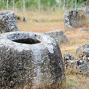 Some of the stone jars at Site 1 of the Plain of Jars in north-central Laos. Much remains unknown about the age and purpose of the thousands of stone jars clustered in the region. Most accounts date them to at least a couple of thousand years ago and theories have been put forward that they were used in burial rituals.