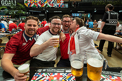 © Licensed to London News Pictures. 13/06/2021. LONDON, UK. Jubilant England fans gather at Boxpark Wembley for the England v Croatia match at Wembley Stadium for the 2020 UEFA European Football Championship, commonly known as Euro 2020. The tournament was postponed from 2020 due to the COVID-19 pandemic in Europe and rescheduled for 11 June to 11 July 2021 with matches to be played in 11 cities. Wembley Stadium will host certain group matches, as well as the semi-finals and final itself.  Photo credit: Stephen Chung/LNP