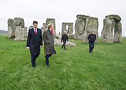 © Licensed to London News Pictures. 01/12/2014. Wiltshire, UK Simon Thurley (red scarf) Director of English Heritage tours the site with Nick Clegg accompanied by Dame Helen Ghosh, Director-General of the National Trust and  Alistair Sommerlad, Chair of the new Stonehenge and Avebury WHS Partnership Panel. British Prime Minister Nick Clegg visits The World Heritage Site of Stonehenge in Wiltshire today 1st December 2014. A tunnel passing Stonehenge is among dozens of new road schemes announced by the government, as part of £15bn of improvements to England's roads.. Photo credit : Stephen Simpson/LNP