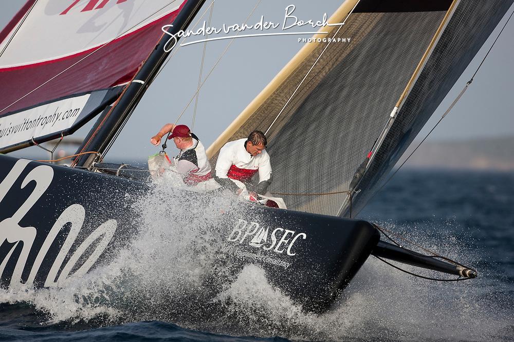 Andy Fethers and Phil Jameson on the bow. Artemis (SWE) vs Emirates Team New Zealand (NZL). La Maddalena, Sardinia, June 1st 2010. Louis Vuitton Trophy  La Maddalena (22 May -6 June 2010) © Sander van der Borch / Artemis