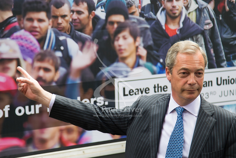 """Smith Square, Westminster, London, June 16th 2016. UKIP leader Nigel Farage launches his """"biggest ever"""" advertising campaign as Leave and Remain enter their last week of campaigning before the EU referendum on June 23rd. PICTURED: Nigel Farage poses for the media in front of his new anti-immigration billboard that claims the UK is at breaking point."""