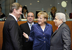 """Angela Merkel, Germany's chancellor, center, introduces Guido Westerwelle, her new foreign minister, to Dimitris Christofias, president of Cyprus, right as Markos Kyprianou, the foreign minister of Cyprus, looks on from behind, during the European Union Summit at the EU headquarters in Brussels, Belgium, on Thursday, Oct. 29, 2009. European Union leaders are set for """"very difficult"""" talks to overcome the Czech Republic's resistance to a new governing treaty designed to strengthen the EU's influence in world affairs, Reinfeldt said. (Photo © Jock Fistick)"""
