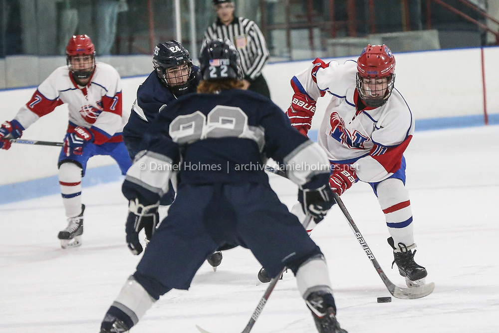 (12/9/17, NATICK, MA) Natick's Peter Manoli skates around the defense during the boys hockey game against Framingham at Chase Arena in Natick on Saturday. [Daily News and Wicked Local Photo/Dan Holmes]