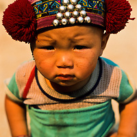 Yao Hill Tribe infant girl sports a cute hat, Muang Singh, Laos