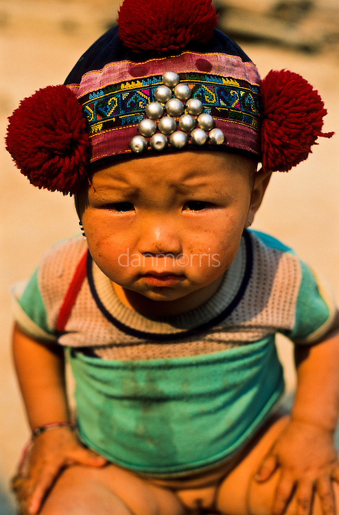 Yao Hill Tribe infant girl sports a cute hat, Muang Singh, Laos