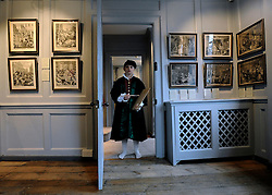 © Licensed to London News Pictures. 07/11/2011. London, UK. Peter aged 10, from The William Hogarth Primary School, wears clothes similar to what Hogarth would have worn in the 18th Century in a room with original Hogarth prints hanging on the wall of the house. The restoration project at Hogarth's House, built in 1750, in Chiswick, West London is completed today 7th November 2011. The house, once Hogarth's residence holds a collection of the artist's 18th century prints and engraving plates. The house suffered damage from a major fire during the restoration. Photo credit : Stephen Simpson/LNP