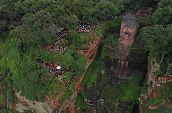 October 4, 2018 - Leshan, China - People view the statue of the Leshan Giant Buddha in Leshan City, southwest China's Sichuan Province. The Leishan Buddha scenic area received about 43,800 visitors on the fourth day of China's National Day holiday.  wsw) (Credit Image: © Jiang Hongjing/Xinhua via ZUMA Wire)