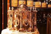 A big silver wine cooler in a wine tasting room with different size Moet & Chandon champagne bottles in the background. Ulriksdal Ulriksdals Wärdshus Värdshus Wardshus Vardshus Restaurant, Stockholm, Sweden, Sverige, Europe