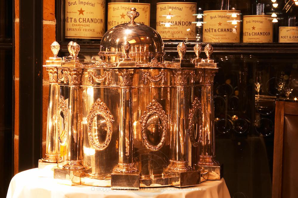 A big silver wine cooler in a wine tasting room with different size Moet & Chandon champagne bottles in the background. Ulriksdal Ulriksdals Wärdshus Värdshus Wardshus Vardshus Restaurant, Stockholm, Sweden, Sverige, Europe