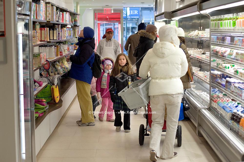 Julia Skutch, 7, and Samantha Goldhersz, 4 walk the isle at Kidfresh, a bright children?s food store on the Upper East Side of Manhattan.