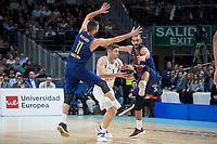 Real Madrid Fabien Causeur and FC Barcelona Lassa Juan Carlos Navarro and Adam Hanga during Turkish Airlines Euroleague match between Real Madrid and FC Barcelona Lassa at Wizink Center in Madrid, Spain. December 14, 2017. (ALTERPHOTOS/Borja B.Hojas)