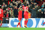 Philippe Coutinho of Liverpool (c) celebrates with his teammates after scoring his teams 1st goal. Capital One Cup Final, Liverpool v Manchester City at Wembley stadium in London, England on Sunday 28th Feb 2016. pic by Chris Stading, Andrew Orchard sports photography.
