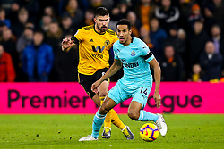 Isaac Hayden of Newcastle United takes on Ruben Neves of Wolverhampton Wanderers - Mandatory by-line: Robbie Stephenson/JMP - 11/02/2019 - FOOTBALL - Molineux - Wolverhampton, England - Wolverhampton Wanderers v Newcastle United - Premier League