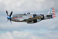 New Windsor, New York - A World War II P-51D Mustang flies during a practice session for the New York Air Show at Stewart International Airport on Aug. 28, 2015. ©Tom Bushey / The Image Works