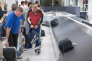 passengers getting there luggage Amsterdam airport