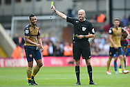 Referee Lee Mason books Francis Coquelin of Arsenal for fouling Yannick Bolasie of Crystal Palace. Barclays Premier league match, Crystal Palace v Arsenal at  Selhurst Park in London on Sunday 16th August 2015.<br /> pic by John Patrick Fletcher, Andrew Orchard sports photography.
