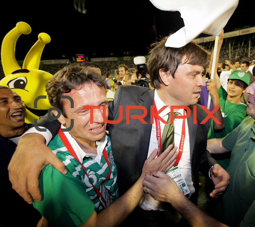 Turkish soccer team Bursaspor head coach Ertugrul SAGLAM (R) happy tears of joy to celebrate the championship during their Turkish soccer super league match Bursaspor between Besiktas at Ataturk Stadium in Bursa Turkey on Sunday, 16 May 2010. Photo by TURKPIX