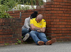 Fans sleep outside the ground before the Sky Bet Championship match at Elland Road, Leeds.
