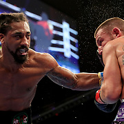 HOLLYWOOD, FL - APRIL 17:  Demetrius Andrade lands a punch on Liam Williams during the WBO Middleweight Championship fight at Seminole Hard Rock Hotel & Casino on April 17, 2021 in Hollywood, Florida. (Photo by Alex Menendez/Getty Images) *** Local Caption *** Demetrius Andrade; Liam Williams