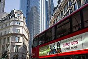 A bus with an ad for an educational college passes through the  in the City of London, the capital's financial district (aka the Square Mile), on 22nd August 2019, in London, England. The College of Haringey, Enfield and North East London (CONEL) offers a wide range of apprenticeships, pre-apprenticeships and courses across many different subjects to give students the skills, knowledge and experience they need to succeed at work or university.