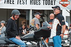 Art Anderson about to test ride a Flat Black Harley-Davidson Road Glide in the test ride area of Black Hills Harley-Davidson during the annual Sturgis Black Hills Motorcycle Rally. SD, USA. August 5, 2014.  Photography ©2014 Michael Lichter.