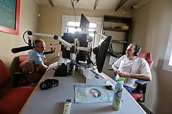 18 August. New Orleans, Louisiana.<br /> Radio NOLA HIV 102.3 LPFM.<br /> Chris Rose interviews musician Paul Sanchez on air.<br /> Photo©; Charlie Varley/varleypix.com