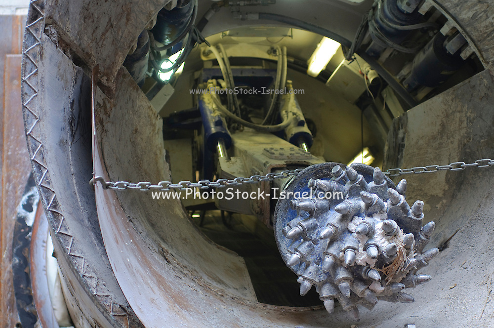 Tunnelling a new underground sewerage pipe under Tel Aviv and the Dan region in Israel. The heavy duty drill bit is being removed at the end of the tunnel