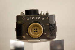 Spy camera disguised as a button at the former Stasi East German state secret police headquarters now museum in Berlin 2009