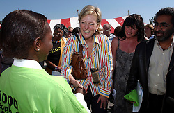 CAPE TOWN, SOUTH AFRICA - APRIL-29-2004 - Princess Astrid talks with a young girl infected with HIV / Aids during the celebration of the 1000th patient to receive ARV drugs in the Khayelitsha Township. There are about 500,000 people living in Khayelitsha and 10% of the population is infected with HIV / AIDS . (REPORTERS © JOCK FISTICK)...<br />