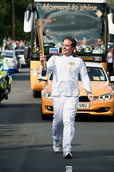 The Olympic Torch relay reaches Sheffield on day 38 coverage from the Chapeltown - Ecclesfield - Parson Cross section of the Journey.<br /> Runner 107 Irigoyen Angulo takes his turn carrying the Olympic flame up Church street in Ecclesfield<br /> 25 June 2012.Image <br /> © Paul David Drabble