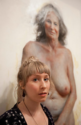 © Licensed to London News Pictures. 20/06/2012. LONDON, UK. The winner of the BP Portrait Award, Aleah Chaplin, stands with her winning portrait 'Auntie' at the National Portrait Gallery in London today (20/0612). The annual British Petroleum sponsored event runs from the 21st of June to the 23rd of September and highlights the work of portrait artists working in a variety of styles and techniques . Photo credit: Matt Cetti-Roberts/LNP