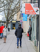 24th February, Cheltenham, England. Shoppers walking through the town centre in Cheltenham during England's third national lockdown.