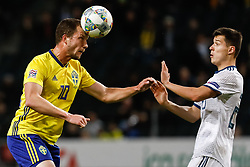 November 20, 2018 - Stockholm, Sweden - Jakob Johansson (L) of Sweden and Dmitri Poloz of Russia vie for the ball during the UEFA Nations League B Group 2 match between Sweden and Russia on November 20, 2018 at Friends Arena in Stockholm, Sweden. (Credit Image: © Mike Kireev/NurPhoto via ZUMA Press)
