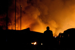 © licensed to London News Pictures. Leyland, UK 22/12/2011. Fire crews tackle a large fire spread across several units on an industrial estate in Leyland. Please see special instructions for usage rates. Photo credit should read Joel Goodman/LNP