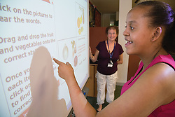 Student learning about independent living using an interactive whiteboard at a special school,