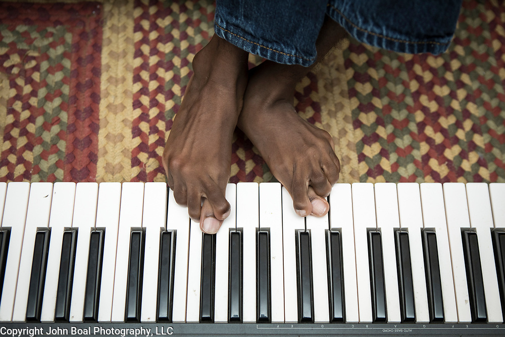 Donald enjoys playing music with the family. He utilizes his feet and toes to play the keyboard, as well as operate his wheelchair. For Novant Health