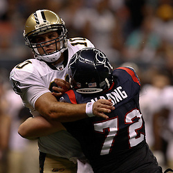 August 21, 2010; New Orleans, LA, USA; New Orleans Saints quarterback Chase Daniel (10) takes a hit after passing from Houston Texans defensive end Jesse Nading (72) during the second half of a 38-20 win by the New Orleans Saints over the Houston Texans during a preseason game at the Louisiana Superdome. Mandatory Credit: Derick E. Hingle