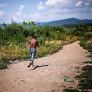 """A young boy running on a path towards river """"Bodva"""" to cool down on a tropical day. His home - the Roma settlement """"Budulovska"""" - is segregated from the city of Moldava nad Bodvou and is located in the fields behind. The image belongs to a long term project about 5 different Roma settlements in the area of Kosice, eastern Slovakia. #humanrights #documentary #photojournalism #roma #settlement #slovakia  #minority #child #latergram #longtermproject #awallrunsthroughit #panos #dailylife #segregation #community #socialissues"""