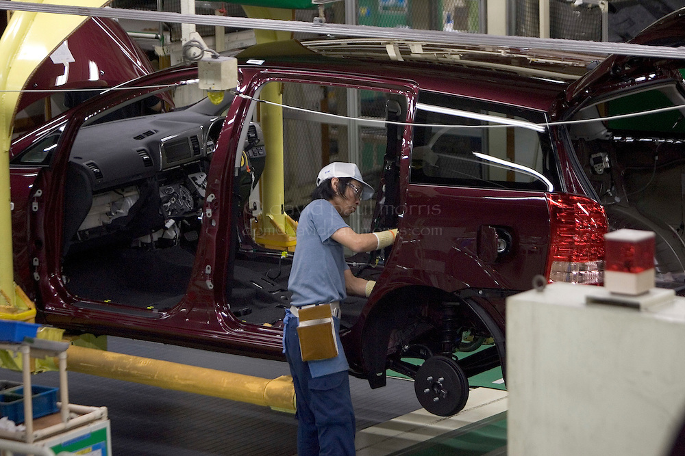 TOYOTA CITY, JAPAN  -  March 22:  Assembly workers work on the new Toyota Prius inside the Toyota Tsutsumi Plant on March 22, 2006 in Toyota City Japan. With the popularity of the Prius in America and other countries Toyota is set to overcome General Motors as the worlds largest auto manufacturer.   (Photo by David Paul Morris)