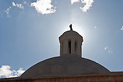Cross and dome on the Spanish mission church in Tumacacori National Historical Park, Arizona