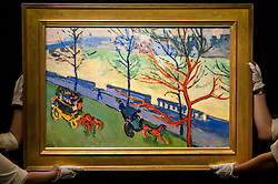 "© Licensed to London News Pictures. 19/06/2015. London, UK. Sotheby's staff show André Derain's ""Londres: Le Quai Victoria"" (est. £6.5m - £9m), at Sotheby's Impressionist, Modern & Contemporary Art preview, ahead of the sale on 24 June 2015. Leading the sale are Kazimir Malevich's, ""Suprematism, 18th Construction"" and Edouard Manet's ""Le Bar aux Folies-Bergère"".  Photo credit : Stephen Chung/LNP"