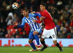 Manchester United's Chris Smalling tackles Brighton & Hove Albion's Leonardo Ulloa