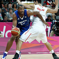 04 August 2012: France Boris Diaw drives past Tunisia Makram Ben Romdhane during 73-69 Team France victory over Team Tunisia, during the men's basketball preliminary, at the Basketball Arena, in London, Great Britain.